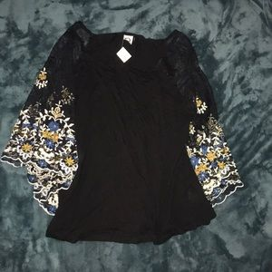 Black shirt with embroidered sleeves